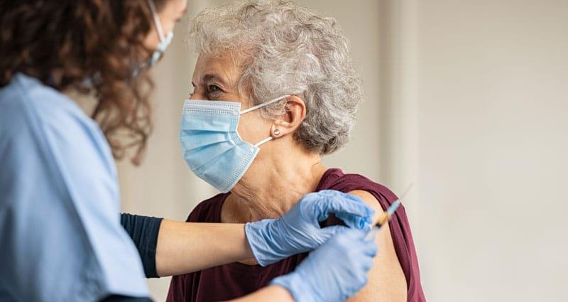 Woman receiving a vaccine.