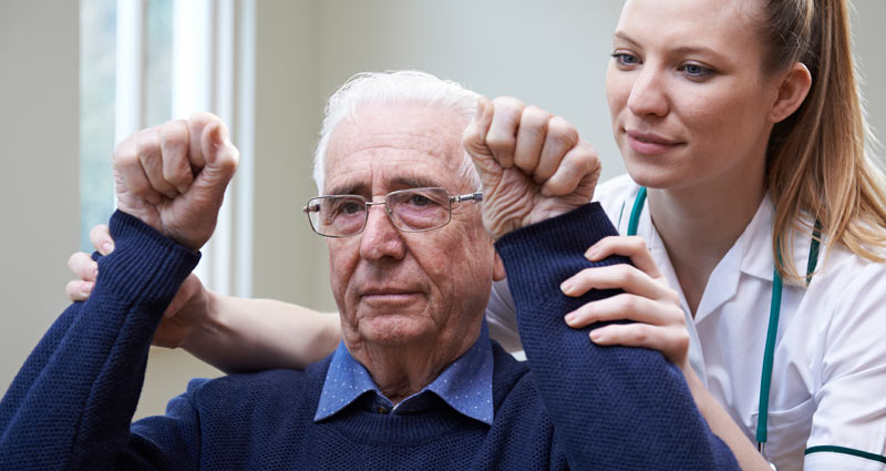 medical professional helping elderly patient