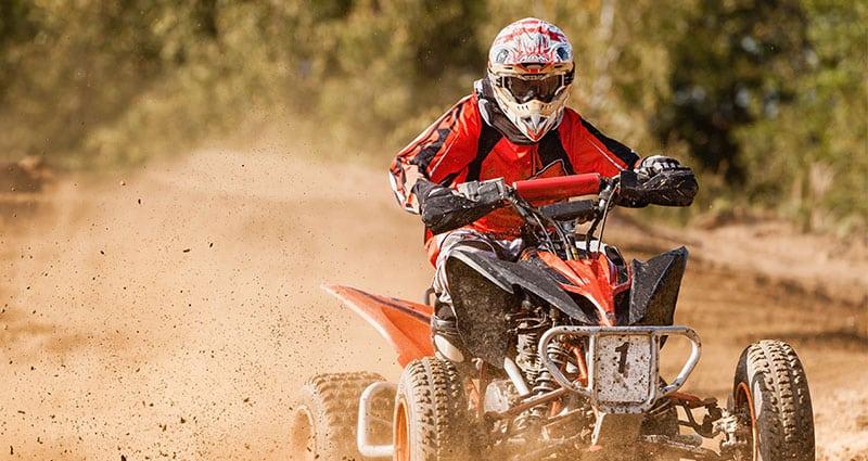 adult riding ATV